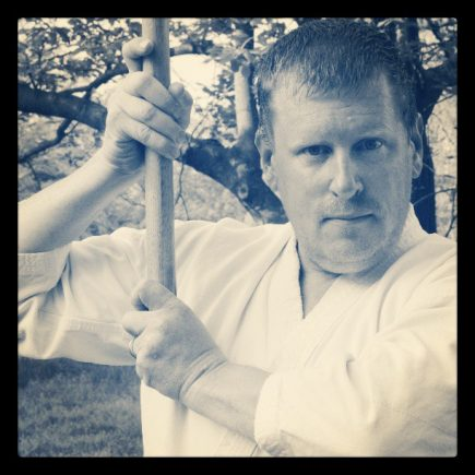 The author, holding a bokken (wooden sword).